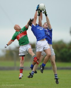 Michael Hogan of Kilmurry Ibrickane in action against Conor Murray and Darren Owens of Kilkee during their senior championship game in Doonbeg. Photograph by John Kelly.