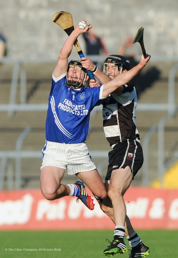 Liam Markham of Cratloe in action against Stephen O Halloran of Clarecastle during their semi-final at Cusack Park. Photograph by John Kelly.