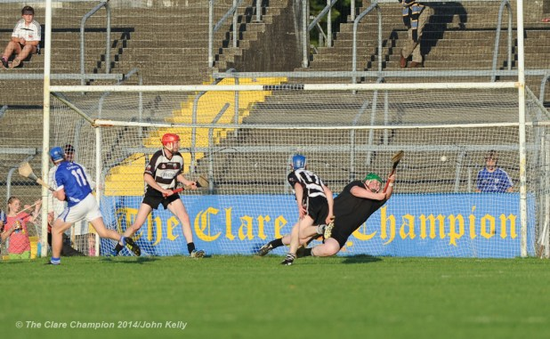 Jamie Coughlan of Clarecastle fails to block the goal effort from Podge Collins of Cratloe during their semi-final at Cusack Park. Photograph by John Kelly.
