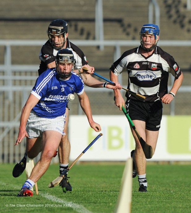 Liam Markham of Cratloe in action against Stephen O Halloran and Bobby Duggan of Clarecastle during their semi-final at Cusack Park. Photograph by John Kelly.