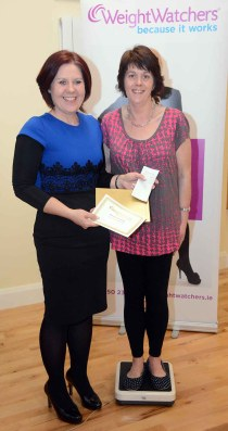 Ennis Weightwatcher leader, Kathleen Shannon, confirms that Niamh has reached her target weight.