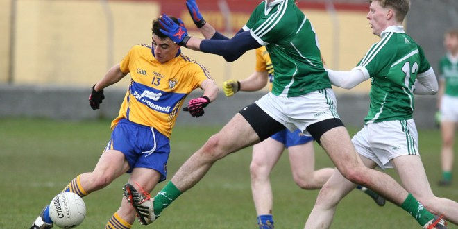 Clare's Sean Rouine under pressure from Limerick's Josh Ryan at Miltown on Wednesday night. Photograph by Arthur Ellis