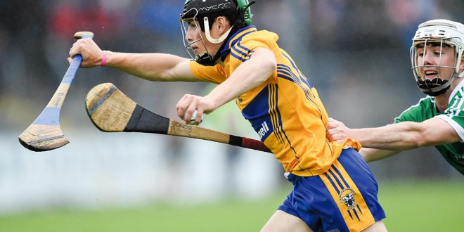 Gary Cooney of Clare in action against Conor Flahive of Limerick during their Munster Minor Hurling Championship semi-final at Cusack Park. Photograph by John Kelly.