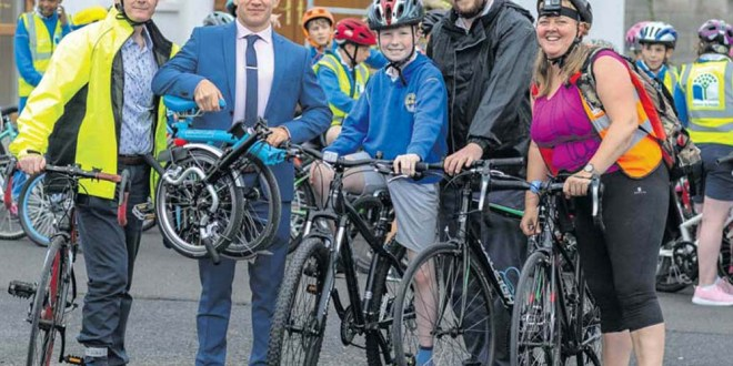 At the School Cycle at Ennis Fire Station on Wednesday were, from left, Clare Champion managing director John Galvin; Clare hurler and advertising sales representative of The Clare Champion, David Reidy, CBS pupil Mark Glynn and his dad, Darragh and organiser, Róisín Garvey.