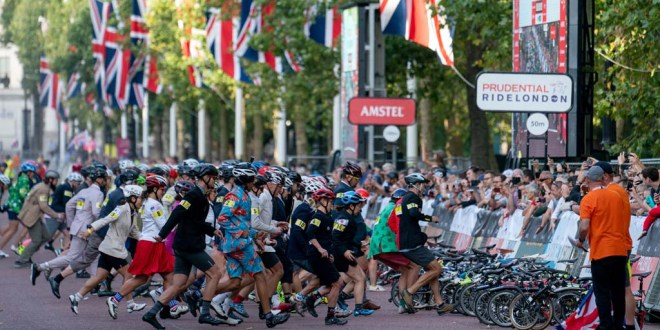Competitors race towards their bikes at the start of the Brompton World Championships in London.