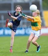 Lucy Power of Barefield NS in action against Sophie Leahy of Knockanean NS during their Division 1 LGFA Ladies Football Primary Schools final at Cusack park. Photograph by John Kelly