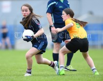 Kiah Kenneally of Barefield NS in action against Maeve Barry of Knockanean NS during their Division 1 LGFA Ladies Football Primary Schools final at Cusack park. Photograph by John Kelly