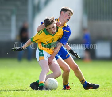 Brian Keane of Carrigaholt/Moveen in action against James Costello of Carron/New Quay,Ballyvaughan/Fanore during their Primary Schools Div 3 Football 11-Aside final at Kilrush. Photograph by John Kelly
