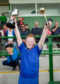 Oisin Mc Namara of Carron/New Quay,Ballyvaughan/Fanore lifts the cup and his man of the match award following the Primary Schools Div 3 Football 11-Aside final at Kilrush. Photograph by John Kelly