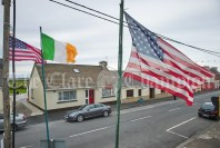 The US flag and the tricolor flying high in the Long Village, ahead of the visit of the United States President Donald J. Trump to his Golf Club at Doonbeg. Photograph by John Kelly