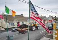 Turf's Coming Home....A tractor drawing home the turf passes by the US and the tricolor in the Long Village, ahead of the visit of the United States President Donald J. Trump to his Golf Club at Doonbeg. Photograph by John Kelly