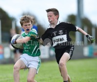 James Blunnie of Kilrush in action against Ian Ryan of Doonbeg during their Primary Schools Div 2 Football 13-Aside final at Kilrush. Photograph by John Kelly