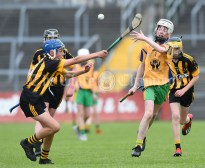 Eoin Kennedy of Ballyea in action against Jack Cullinan of Inagh/Cloonanaha during their Schools Division 2 final at Cusack Park. Photograph by John Kelly
