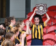 Rachel Danaher of Ogonelloe lifts the trophy following the win over Stonehall/Ballycar in their Schools Division 4 camogie final at Cusack Park. Photograph by John Kelly