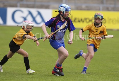 120619 Parteens Aoife Keogh under pressure from Clonmoneys Kate Jones and Aoibhe O'Laery during the Division 5 Camogie Clare Primary School Finals .Pic Arthur Ellis
