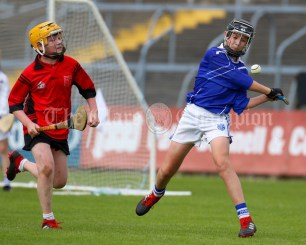 120619 Cratloes Eoin Carey clears under pressure from Ennis NS's Johnny Lyons in the Division 1 final.Pic Arthur Ellis