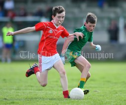 Colm Downes of Kilmurry Mc Mahon/Labasheeda in action against Liam Curtin of Rineen during their Primary Schools Div 4 Football 9-Aside final at Kilrush. Photograph by John Kelly