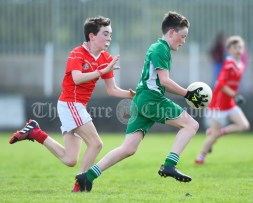 Colm Downes of Kilmurry Mc Mahon/Labasheeda in action against Gavin Twomey of Rineen during their Primary Schools Div 4 Football 9-Aside final at Kilrush. Photograph by John Kelly