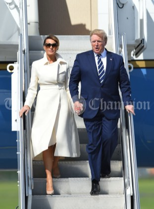 President of the United States Of America Donald J. Trump accompanied by First Lady Melania Trump, steps out of Air Force 1 at Shannon. Photograph by John Kelly.
