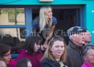 Rita Mc Inerney peers out from the doorway of her cafe ahead of a walkabout by Eric and Don Junior Trump in Doonbeg Village. Photograph by John Kelly