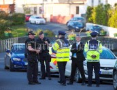 Tight security ahead of a walkabout by Eric and Don Junior Trump in Doonbeg Village. Photograph by John Kelly