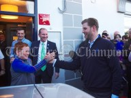 Eric Trump is greeted warmly as he arrives for a walkabout in Doonbeg Village. Photograph by John Kelly