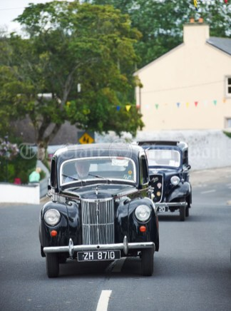Oliver Garry leads the vintage cars during the annual parade as part of the Dan Furey Festival in Labasheeda. Photograph by John Kelly