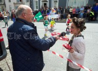 MC Martin Keane is offered a cuppa by Mrs Doyle aka Grace Lorigan during the Cultural Parade as part of the annual Festival Of Fun in Kilmihil. Photograph by John Kelly