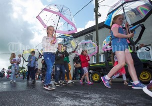 Expecting rain during the Cultural Parade as part of the annual Festival Of Fun in Kilmihil. Photograph by John Kelly