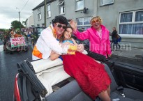 Caoimhe Dennehy is embraced by Elvis, aka Joe Cleary and pal Joe Keane during the Cultural Parade as part of the annual Festival Of Fun in Kilmihil. Photograph by John Kelly