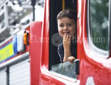 Cian Shallis taking a spin in a fire truck during the Cultural Parade as part of the annual Festival Of Fun in Kilmihil. Photograph by John Kelly