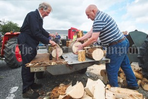 PJ Coughlan and Dinny Mc Carthy demonstrate a wood splitting machine during the Vintage Rally and field day as part of the annual Festival Of Fun in Kilmihil. Photograph by John Kelly
