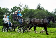 Niamh and David Neylon with their children Ellen, Liam and Paddy, taking a spin with Michael O Dea at Kildysart Show. Photograph by John Kelly
