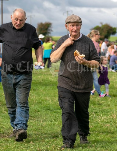 250819 Martin O'Brien, Knockjames and Thomas Leonard, Derrybrien, sampling the burgers at Kilmurry Festival Field Day on Sunday.Pic Arthur Ellis.