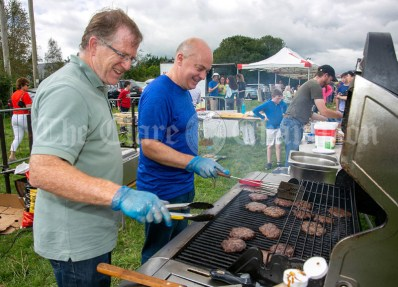 250819 Kevin Wallace and Dermot Stanley, Kilmurry, feeding the throngs at Kilmurry Festival Field Day on Sunday.Pic Arthur Ellis.