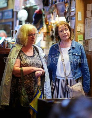 Eilish O Donnell and Martina Bradley look on during a sessiun in Buggles as part of the Kilrush Traditional Music & Set Dancing Festival. Photograph by John Kelly