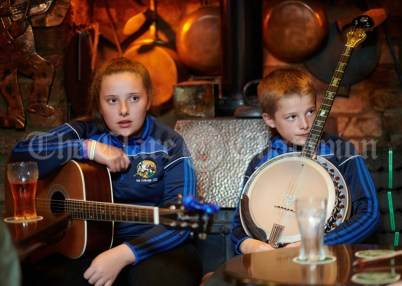 Amy Corry and Cian Corry listening to a sessiun in Buggles as part of the Kilrush Traditional Music & Set Dancing Festival. Photograph by John Kelly