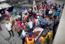 Passengers collect strawberries and fruit before going on the Romantic RNLI Cruise held in association with Bill O Brien's Doolin Ferry Company. Photograph by John Kelly