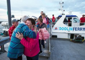 Mary Shannon hugs Joe Queally after disembarking the boat following the Romantic RNLI Cruise held in association with Bill O Brien's Doolin Ferry Company. Photograph by John Kelly