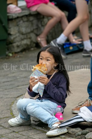 020819 Saoirse Lowry Cummings enjoying her lunch at the Scariff harbour festival on Sunday.pic Arthur Ellis.