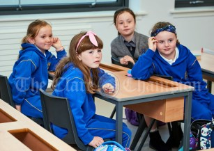 Third class pupils Ava O Reilly, Lexi Cauley, Jessica Coffey and Grace Murphy settle in during the first day of school at the newly built Ennis CBS primary school. Photograph by John Kelly