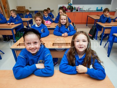 Emily Noonan, Sophie Mc Quaid and friends settle into their new classroom during the first day of school at the newly built Ennis CBS primary school. Photograph by John Kelly