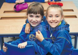 Friends Cara O Loughlin Kelly and Olivia Shannon, all excited during the first day of school at the newly built Ennis CBS primary school. Photograph by John Kelly