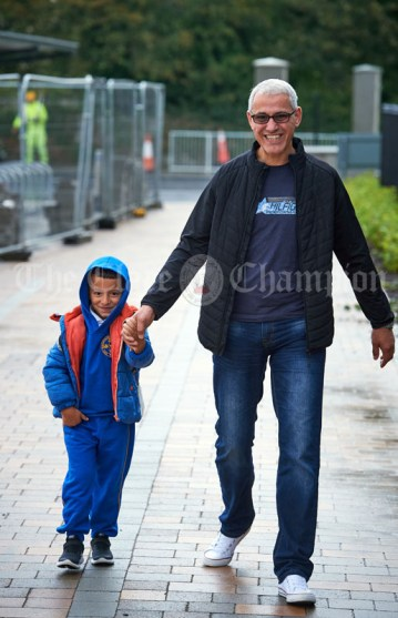Junior infant Rayna Jedir arrives with huis dad Abdil for the first day of school at the newly built Ennis CBS primary school. Photograph by John Kelly