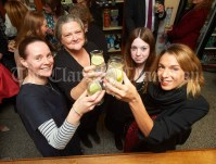 Emily O Dwyer, co-ordinator, Margaret O Brien, Programme Director, Margaret Whitworth, Ennis Chamber, and Aoife Spelman, content and Instagram co-ordinator, at the launch of Ginis, a new limited edition Gin, at the official opening of the Clare Food And Drink Fleadh in Fawl's Bar, Ennis. Photograph by John Kelly
