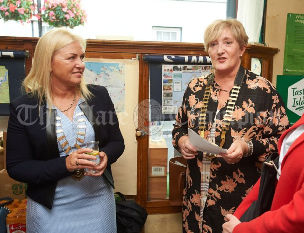 Gwen Culligan of Ennis Chamber addresses the gathering flanked by Mayor Anne Norton at the launch of Ginis, a new limited edition Gin, at the official opening of the Clare Food And Drink Fleadh in Fawl's Bar, Ennis. Photograph by John Kelly