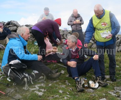 RNLI's Joe Queally hands out black pudding to hungry walkers during the Burren Ramble on Sunday at Fanore.