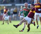 Brian Curtin of Miltown in action against Michael Hogan of Kilmurry Ibrickane during their senior football county final at Cusack Park. Photograph by John Kelly.
