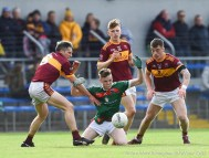 Daniel Walsh of Kilmurry Ibrickane in action against Gordon Kelly (C) , Cormac Murray and Kieran Malone of Miltown during their senior football county final at Cusack Park. Photograph by John Kelly.