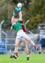 Keith King (C) of Kilmurry Ibrickane in action against Conor Cleary of Miltown during their senior football county final at Cusack Park. Photograph by John Kelly.